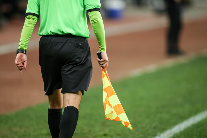 Details of a linesman referee during a soccer game